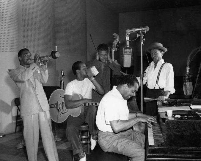 "RIP local jazz legend Gerald Wilson, pictured here on trumpet with Irving Ashby (guitar), George ""Red"" Callender (holding his hands over his ears), Lee Young Sr (drums), and Phil Moore (piano). (Order # 00052121, Security Pacific National Bank Collection)"